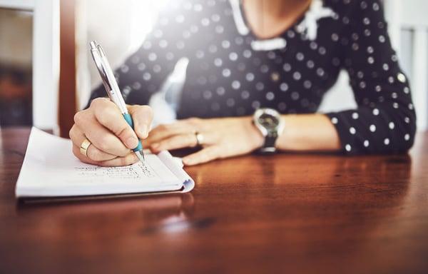 Girl Making Outline in Journal