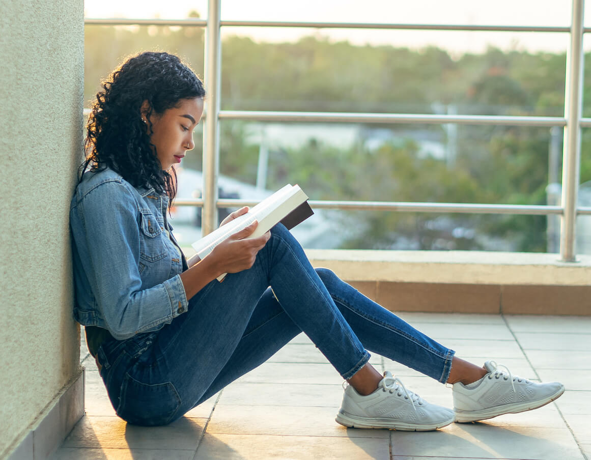 Student Reading a Book