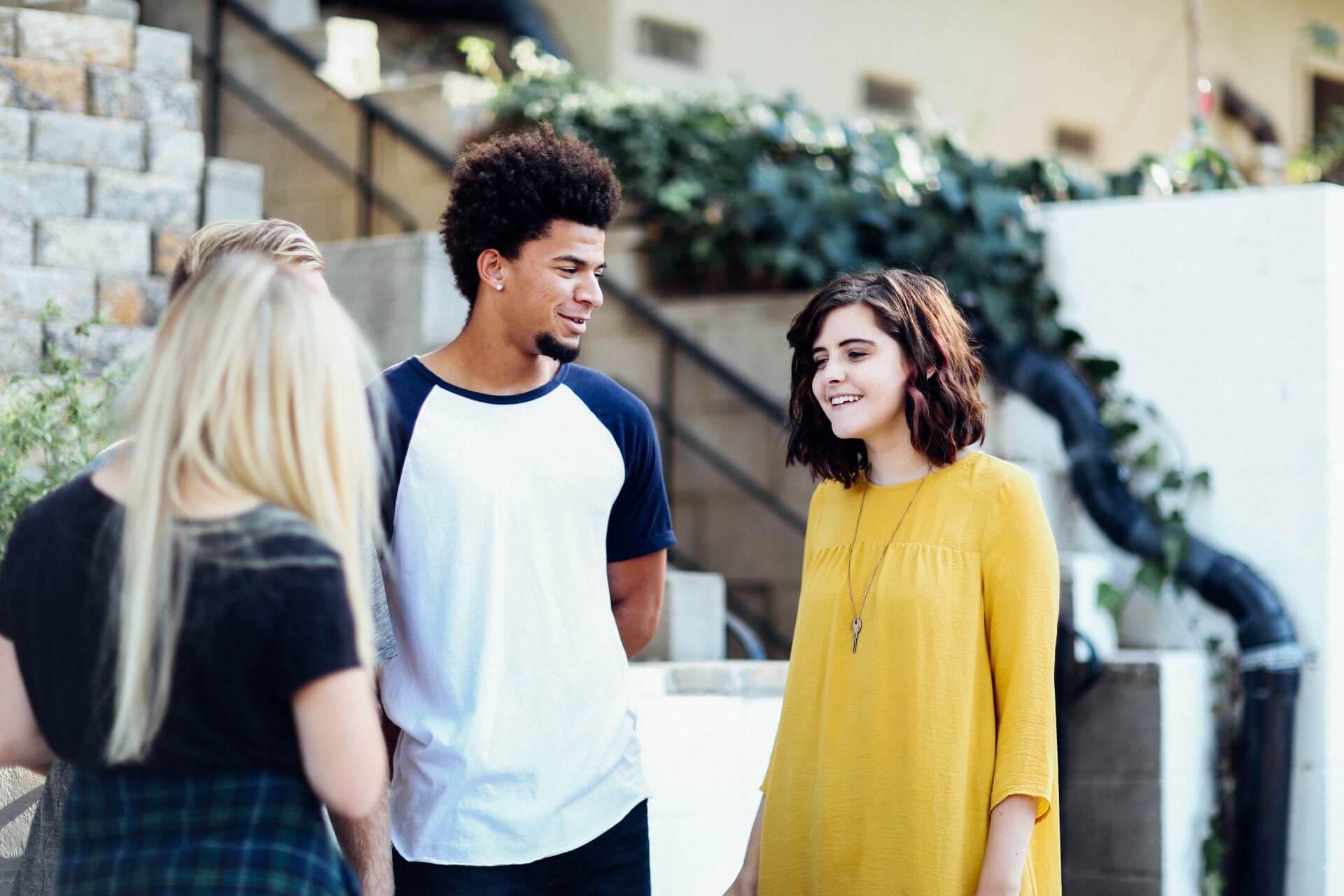 college kids talking  - alexis-brown-85793-unsplash
