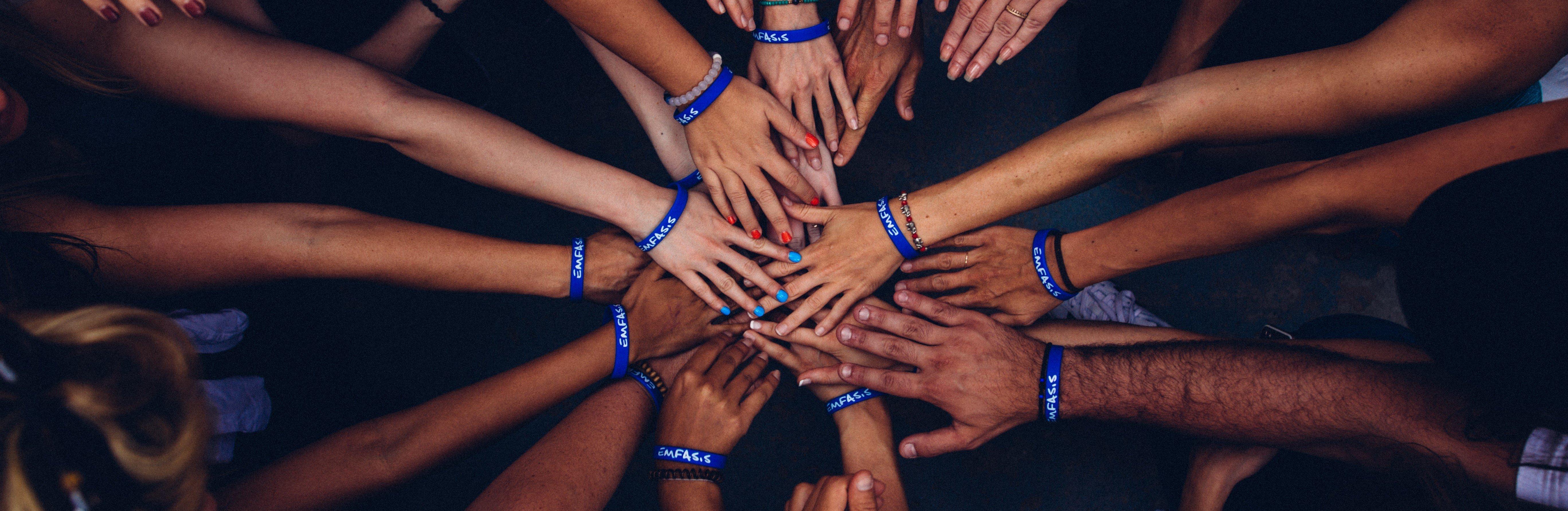hands volunteering banner - perry-grone-732606-unsplash