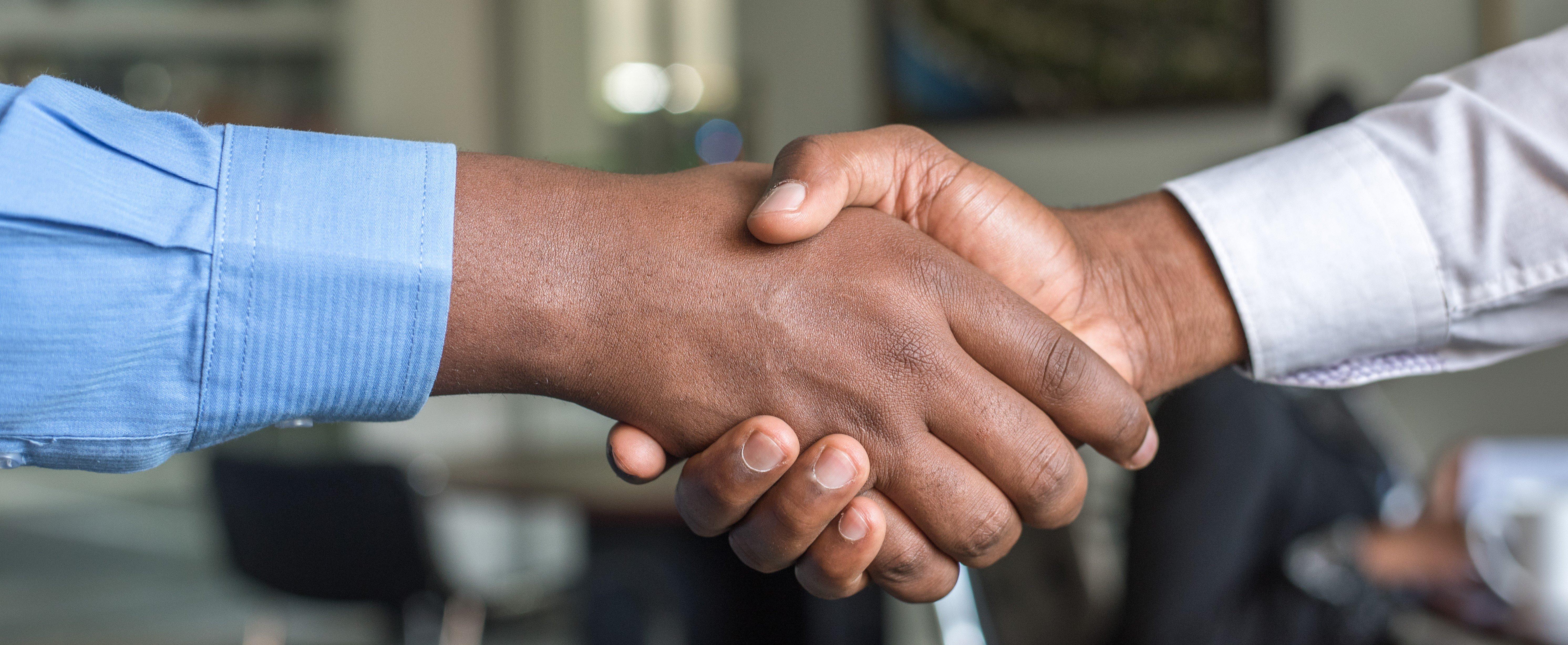 handshake banner - cytonn-photography-604681-unsplash