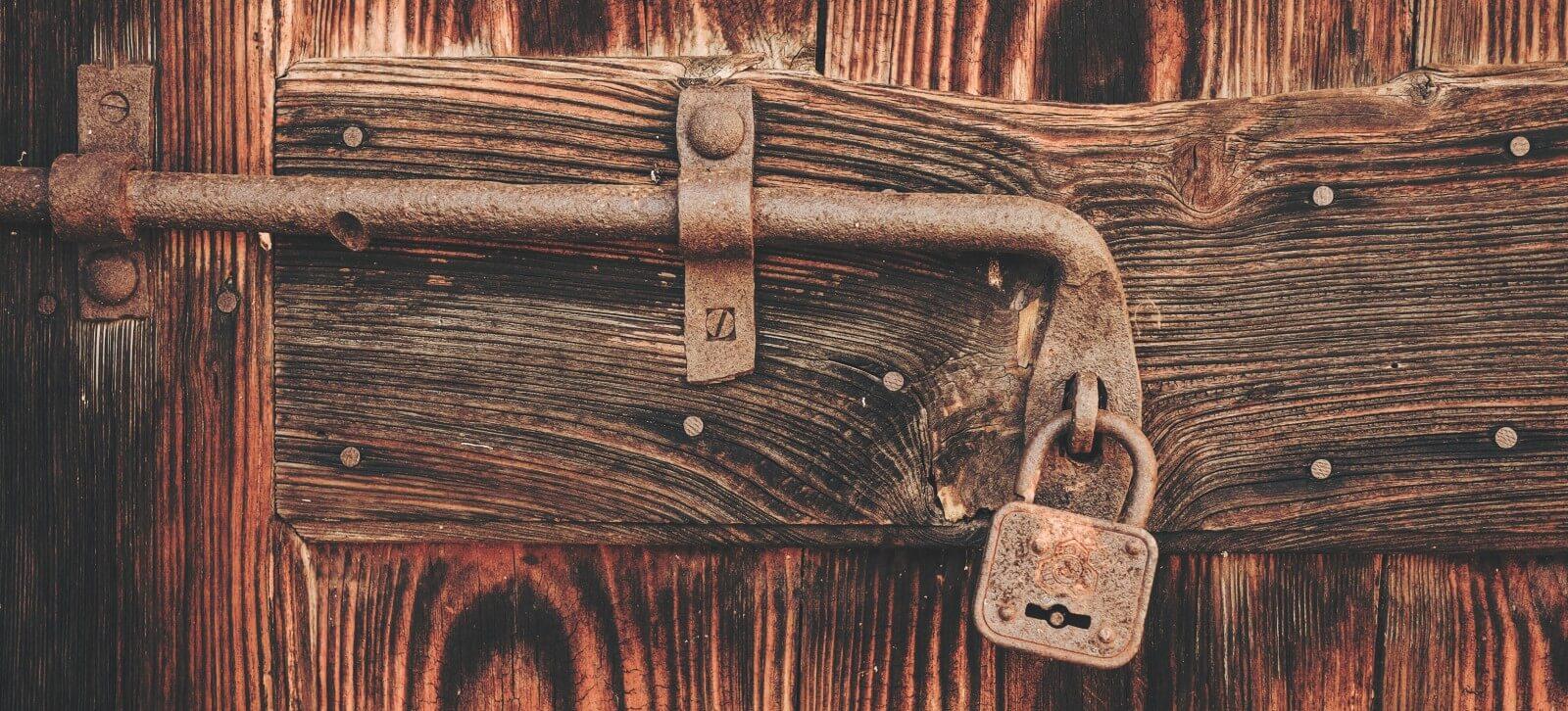 locked door banner - cristina-gottardi-maaWpQVgi00-unsplash