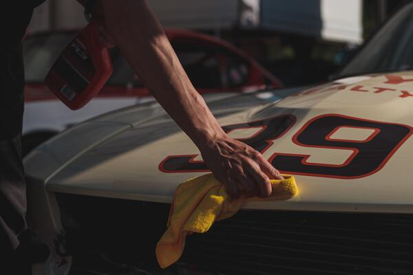 polishing a car - matthew-dockery-s99-JP8P3Hg-unsplash