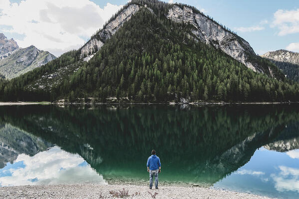 Writing in Detail Paints a Picture - this picture is a man standing in front of a mountain