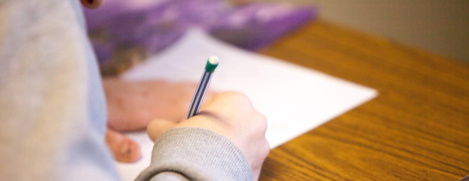 student writing banner - ben-mullins-785450-unsplash