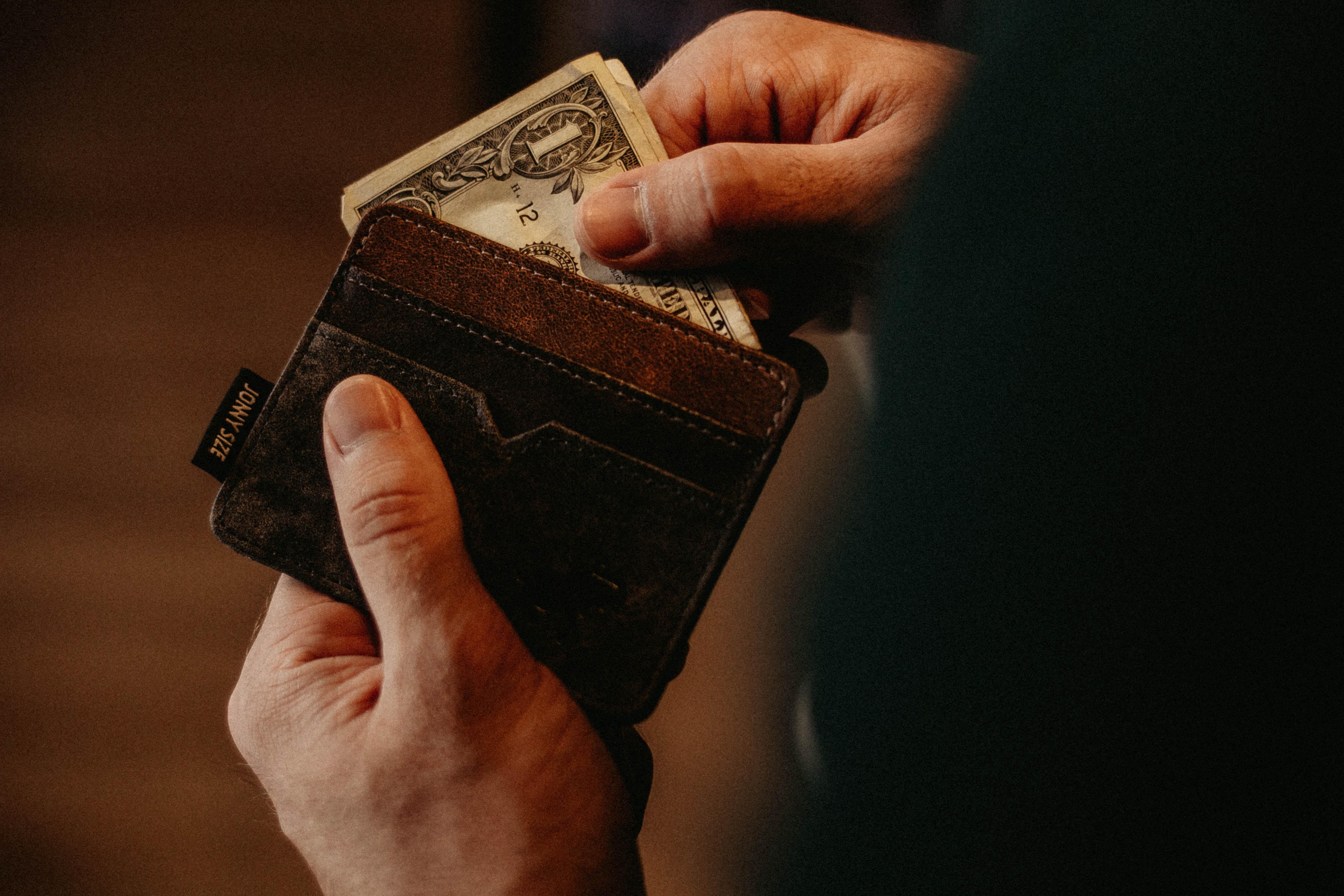 wallet with money - allef-vinicius-468838-unsplash